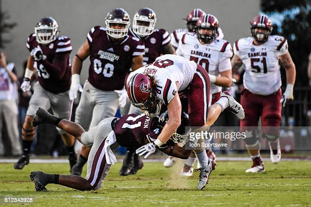 South Carolina Gamecocks tight end Hayden Hurst is tackled by Mississippi State Bulldogs defensive back Mark McLaurin during the Mississippi State...