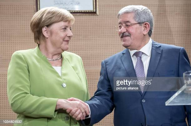 German Chancellor Angela Merkel and Algerian Prime Minister Ahmed Ouyahia attending a joint press conference at the International Conference Centre...