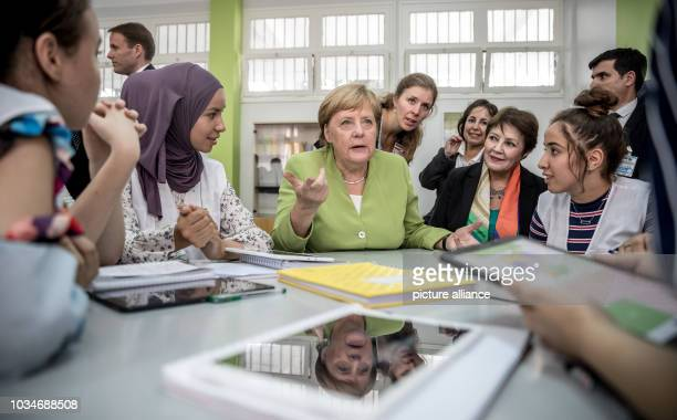 German Chancellor Angela Merkel speaks to German students at the Lycée Aicha Oum el Mouminine School The Lycée Aicha Oum ElMouminin is a state girls'...