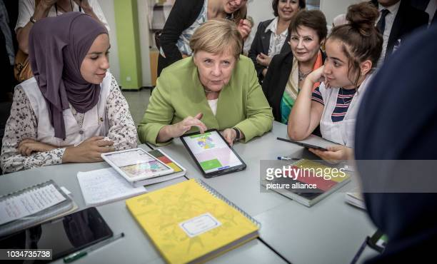 German Chancellor Angela Merkel talking about her homeland to students in German class in the Lycée Aicha Oum el Mouminine School The Lycée Aicha Oum...