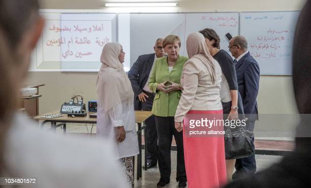 German Chancellor Angela Merkel talking to teachers in the Lycée Aicha Oum el Mouminine School The Lycée Aicha Oum ElMouminin is a state girls'...