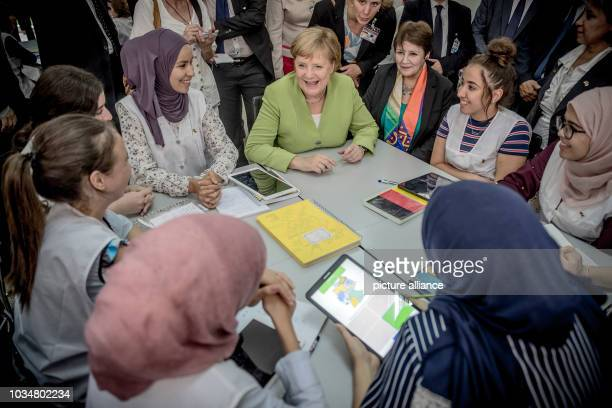 German Chancellor Angela Merkel talking to students in German class in the Lycée Aicha Oum el Mouminine School The Lycée Aicha Oum ElMouminin is a...