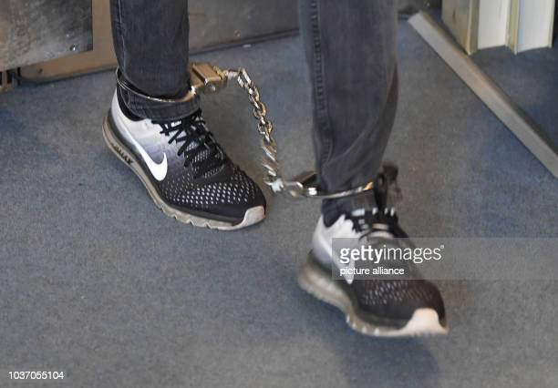 21 September 2018 BadenWuerttemberg Karlsruhe A defendant in a mafia trial is led into the courtroom of the Karlsruhe Regional Court in shackles Nine...