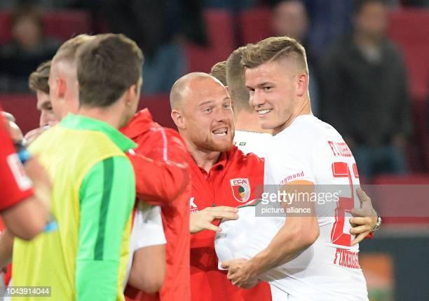 Soccer Bundesliga FC Augsburg SC Freiburg 6th matchday in the WWKArenaKArena Augsburg triple goal scorer Alfred Finnbogason hides the match ball...