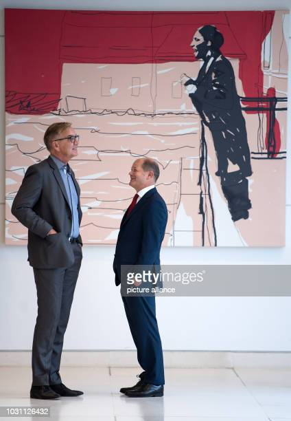 Berlin Dietmar Bartsch Chairman of the parliamentary group of the party Die Linke and Olaf Scholz Federal Minister of Finance talk in a corridor in...