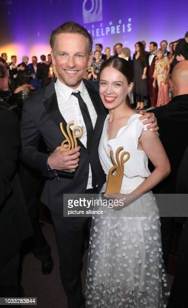 """September 2018, Berlin: Actor Barry Atsma holds the German Acting Award in the category """"Actor in a leading role"""" alongside actress Paula Beer with..."""