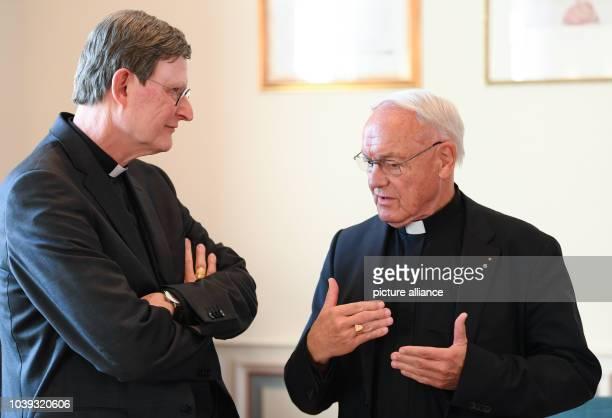 Cardinal Rainer Maria Woelki Archbishop of Cologne and Heinz Josef Algermissen Bishop Emeritus of Fulda meet in the meeting room at the beginning of...