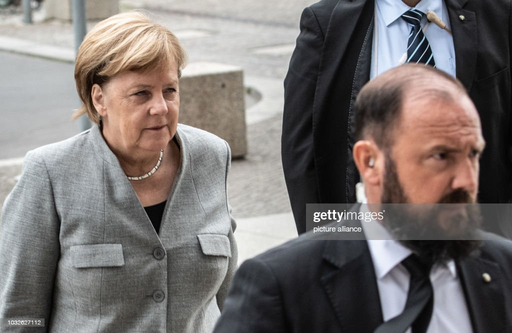 Chancellor Angela Merkel (CDU) comes to the Bundestag session on the budget, accompanied by a security officer. The main topic of the 49th session of the 19th legislative period is the Federal Government's draft budget 2019 and the federal budget 2018 to 2022. Photo: Paul Zinken/dpa