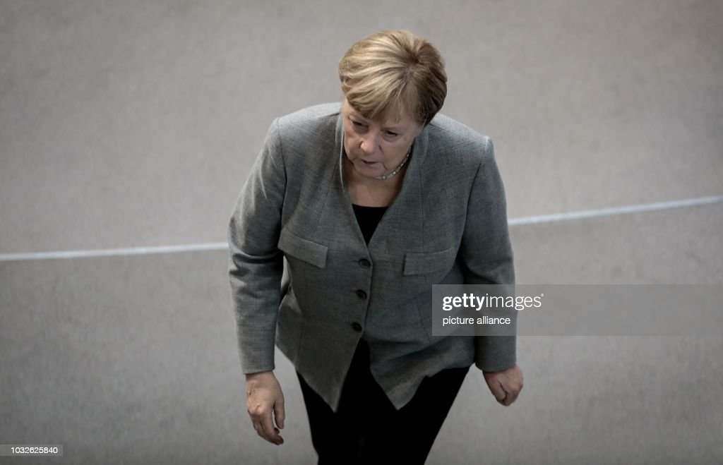 Chancellor Angela Merkel (CDU) will pass through the plenary hall at the plenary session in the German Bundestag. The main topic of the 49th session of the 19th legislative period is the Federal Government's draft budget 2019 and the federal budget 2018 to 2022. Photo: Kay Nietfeld/dpa
