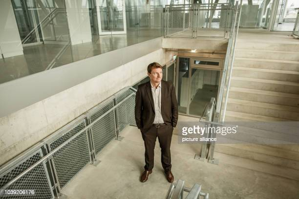 September 2018, Berlin: Georg Löwisch, editor-in-chief of the taz - die tageszeitung, in the staircase of the newspaper's new building. Die...
