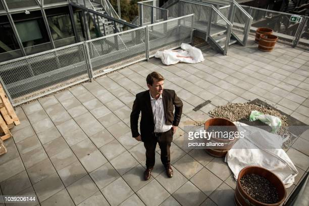 September 2018, Berlin: Georg Löwisch, editor-in-chief of the taz - die tageszeitung, is standing on the roof of the newspaper's new building. Die...