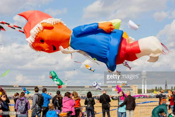 Kites flying at the festival of giant kites of the housing society Stadt und Land on the Tempelhofer Feld Kite aficionados from all over Europe show...