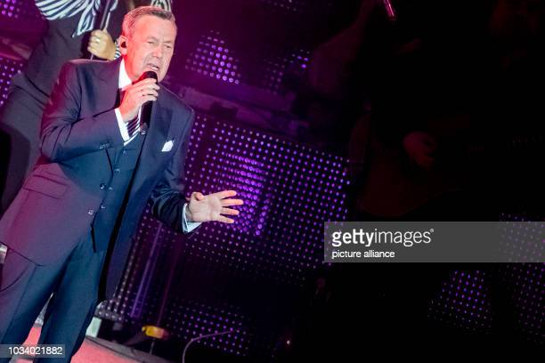 September 2018, Berlin: Pop singer Roland Kaiser sings on the Waldbühne. Photo: Christoph Soeder/dpa