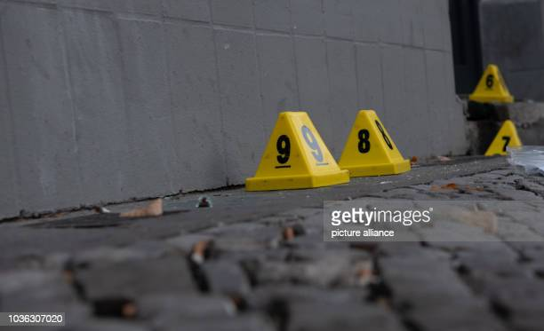 September 2018, Berlin: The yellow hats of the police forensics department are standing in front of the office of a Turkish educational association...