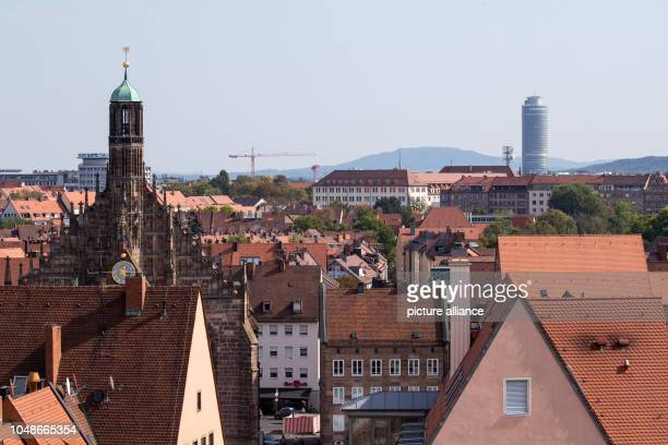 View of the catholic Frauenkirche with the office tower Business Tower and the Moritzberg in the background Photo Daniel Karmann/dpa