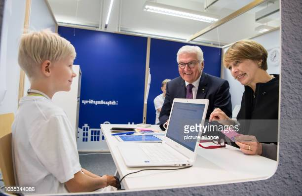 Federal President FrankWalter Steinmeier and his wife Elke Büdenbender visit the school project Me MyCity in Espoo and talk to a boy who had...