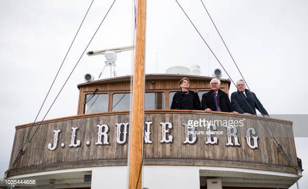 Federal President FrankWalter Steinmeier and his wife Elke Büdenbender together with Stephan Steinlein head of the Office of the Federal President...