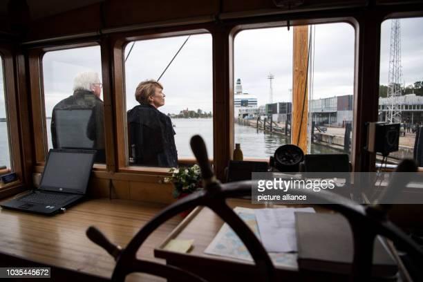 Federal President FrankWalter Steinmeier and his wife Elke Büdenbender take a boat to the Suomenlinna fortress off Helsinki President Steinmeier and...