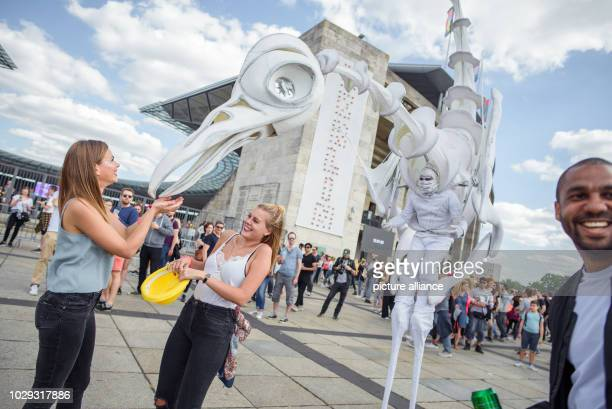 September 2018, Germany, Berlin: Costumed showmen on stilts animate the visitors at the two-day music festival Lollapalooza on the grounds of the...