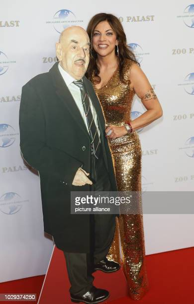 The film producer Alice Brauner stands next to a pop figure of his at the gala on the occasion of her father Artur Brauner's 100th birthday in the...