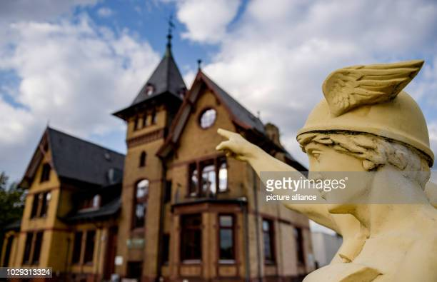 Clouds are moving over a sculpture by the messenger of the gods Hermes which stands next to the museum in the historical villa on the Elbe island of...