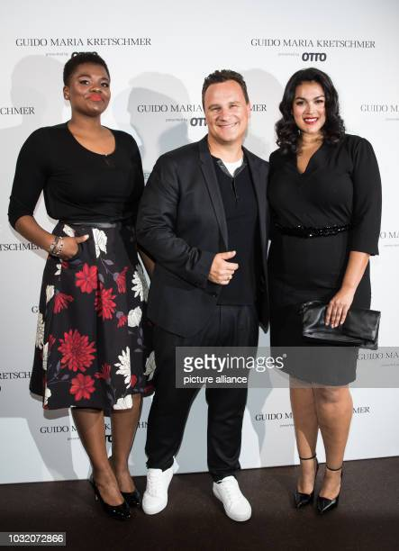 Designer Guido Maria Kretschmer and two models present pieces from his 'Curvy Collection' Under the motto 'Size Revolution' the designer presents his...