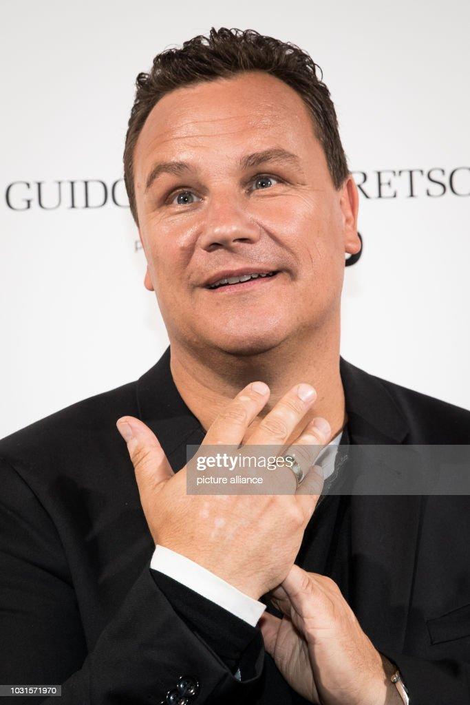 Fashion designer Guido Maria Kretschmer shows his wedding ring at a ... 0ecc65ad2d