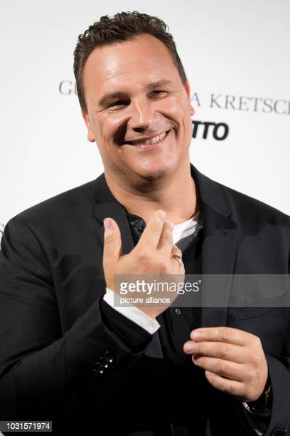 Fashion designer Guido Maria Kretschmer shows his wedding ring at a photo shoot before the presentation of his 'Curvy collection' Under the motto...