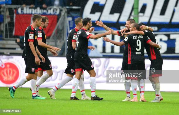 September 2018, Hamburg: Soccer: 2nd Bundesliga, Hamburger SV - Jahn Regensburg in the Volksparkstadion. Jann George from Regensburg celebrates his...