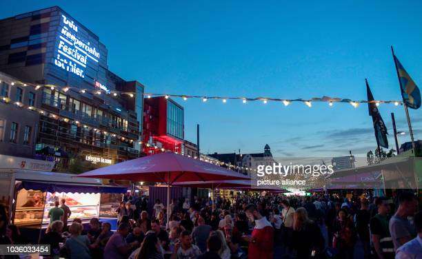 September 2018, Hamburg: The facade of the St. Pauli Clubhouse on Spielbudenplatz is illuminated with the logo of the Reeperbahn Festival. The music...