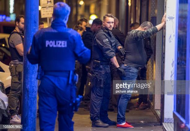 13 September 2018 Hessen Frankfurt_Main Cops searching a man for drugs and prohibited items According to police the largest raid to date in the...