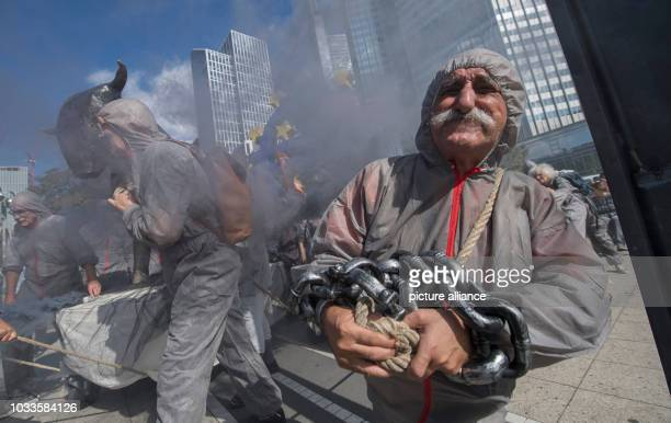 15 September 2018 Hessen Frankfurt_Main Disguised as slaves of the financial system and symbolically chained attac activists are calling for a...