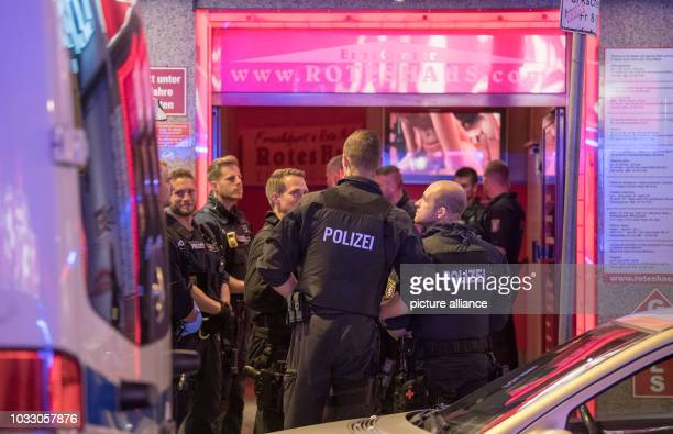 13 September 2018 Hessen Frankfurt_Main Police officers standing in front of a brothel during a raid According to police the largest raid to date in...