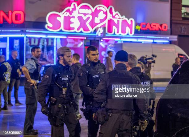 13 September 2018 Hessen Frankfurt_Main Police officers standing in front of a red light establishment According to police the largest raid to date...