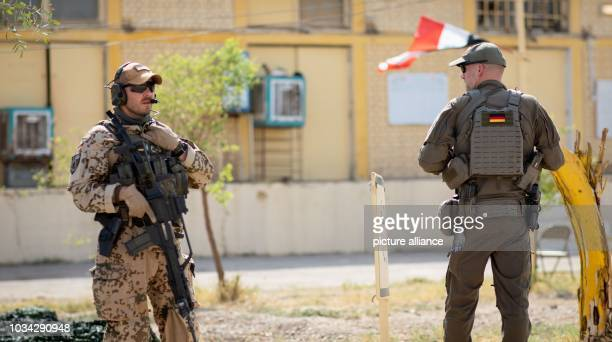 September 2018, Iraq, Taji: A heavily armed German soldier and an official from the Federal Criminal Police Office guarding the visit by Ursula von...