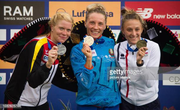 Modern pentathlon World Championship women Annika Schleu from Germany is happy about winning the silver medal at the award ceremony Next to her are...