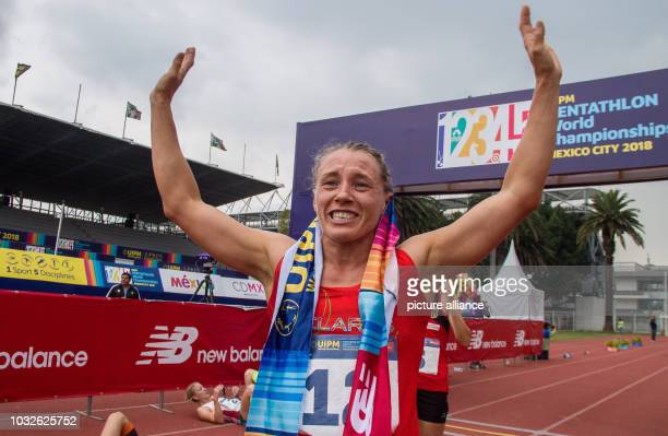 Modern pentathlon World Championship women Anastasia Prokopenko from Belarus is happy about her victory at the finish of the crosscountry race Photo...