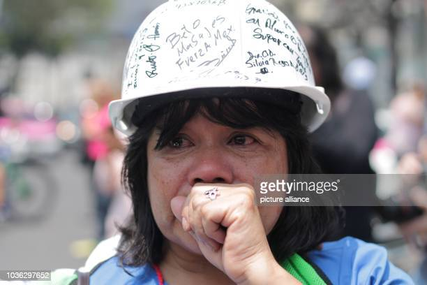 A woman cries at a memorial service for the victims of the earthquakes of September 19 1985 and 2017 one year ago an earthquake of magnitude 71 shook...