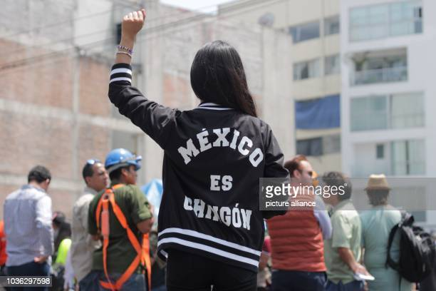 A young woman raises her fist during an event for the victims of the earthquakes of September 19 1985 and 2017 71 magnitude earthquake struck the...