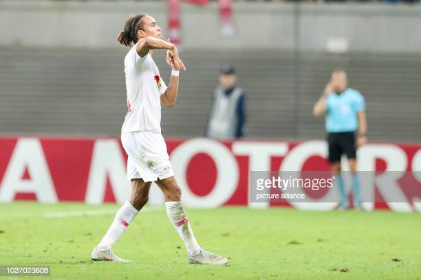 September 2018, Saxony, Leipzig: Soccer: Europa League, Group stage, Matchday 1: RB Leipzig - RB Salzburg. Leipzig's Yussuf Poulsen cheers after his...