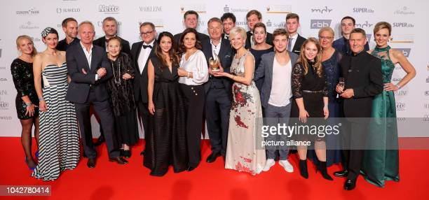 The team of the ARD series 'In aller Freundschaft' showing its 'Goldene Henne' in Leipzig A total of 53 personalities from show business society and...