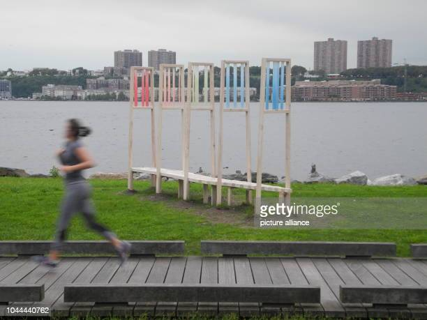 The sculpture Viewfinding by artist Sarah Brook which picks up poems by 26 LGBTQ poets is located in New York's Riverside Park The coloured panels on...