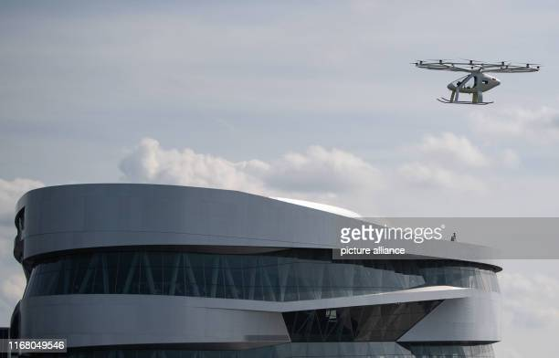 September 2019, Baden-Wuerttemberg, Stuttgart: A so-called Volocopter flies over the Mercedes Benz Museum. The electrically powered vehicle, which...