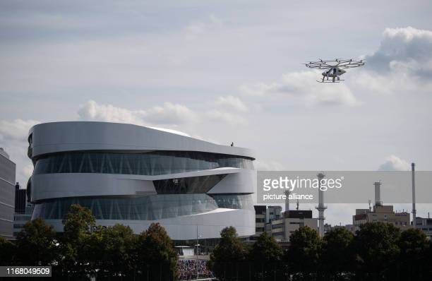 September 2019, Baden-Wuerttemberg, Stuttgart: A so-called Volocopter flies next to the Mercedes Benz Museum. The electrically powered vehicle, which...