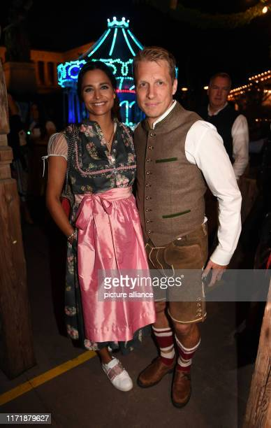September 2019, Bavaria, Munich: Comedian Oliver Pocher and his girlfriend Amira Aly celebrate in the Käfer tent on the Wiesn. The largest folk...