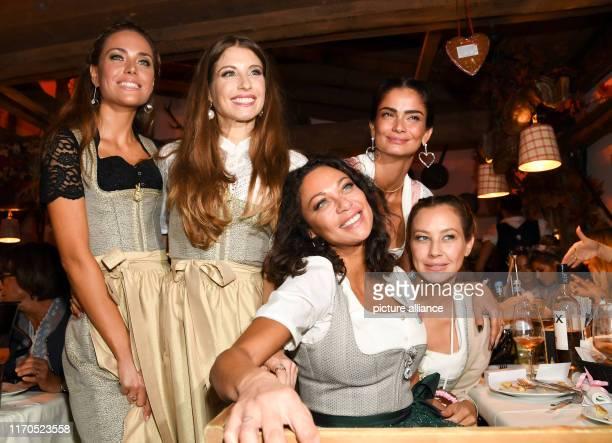 Franca Lehfeldt presenter Cathy Hummels presenter Lilly Becker model Shermine Shahrivar model and Alessandra MeyerWölden model stand and sit together...