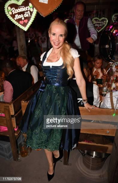 "September 2019, Bavaria, Munich: Oktoberfest 2019, The actress Sylvia Leifheit celebrates at the ""Almauftrieb"" in the Käferzelt. The largest folk..."