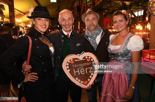 September 2019, Bavaria, Munich: Oktoberfest 2019, The actresses Eva-Maria Grein von Friedl , the CEO of Mainstream Media Gottfried Zmeck, the actor...