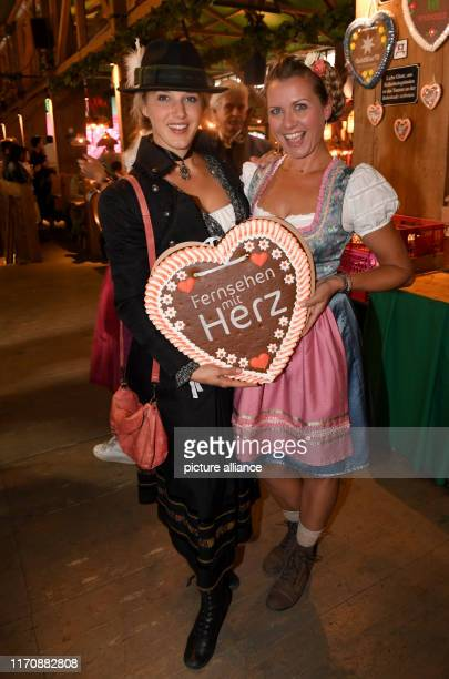 September 2019, Bavaria, Munich: Oktoberfest 2019, The actresses Eva-Maria Grein von Friedl and Jessica Boehrs celebrate in the wine tent at the...