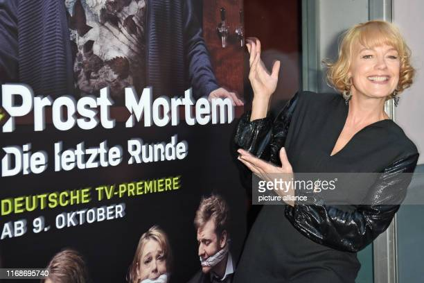 The actress Elke Winkens points to the film poster during the presentation of the TV series Prost Mortem Die letzte Runde in the Rational Theatre The...